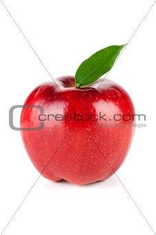 A Ripe Red Apple With Leaf