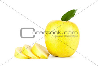 A Ripe Yellow Apple With Leaf