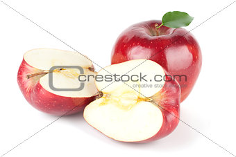 A Ripe Red Apple With Leaf and two halves