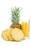 Ripe pineapple and juice glass