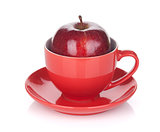 Ripe red apple in tea cup