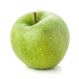 A ripe green apple with water drops