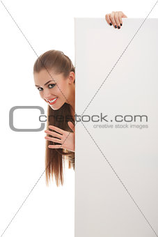 Smiling woman with blank board sign