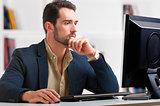 Man Looking At A Computer Monitor