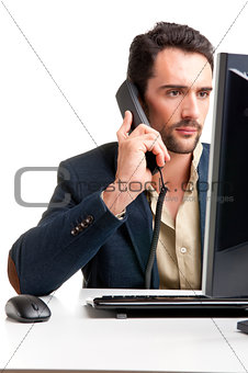 Man Looking At A Computer Monitor, on the phone