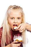 Beautiful blonde girl eating dessert
