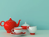 Red dishware on a blue background