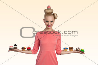 blonde woman with cupcakes on the arms