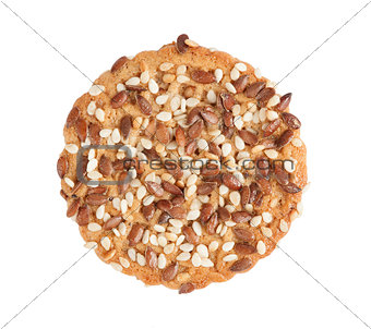 one cookie with seeds isolated on white background