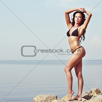 Caucasian young brunette wearing bikini