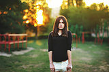 fashionable stylish girl in black shirt outdoor during sunset