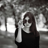 fashionable stylish girl in black shirt wearing sunglasses, blac