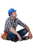 Tired builder taking well earned break
