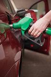 Woman refilling car