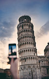 Tourist taking a photo at the Pisa Tower