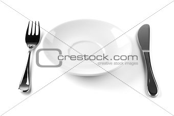 Fork, knife and empty white plate