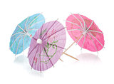 Three colored cocktail umbrellas