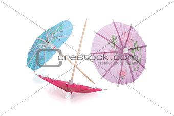 Three colored cocktail umbrella