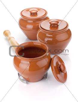 Three clay pots and holder