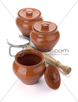 Three clay pots and holder