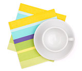 Empty white cup on placemat