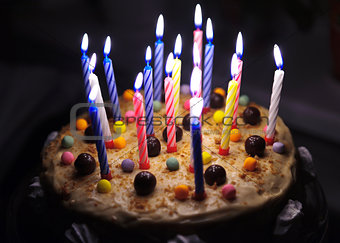 Cake with candles with cream