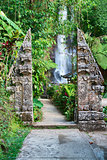 Traditional double stone gate on waterfall