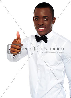 African boy in party-wear gesturing thumbs-up