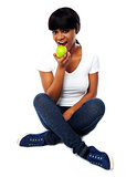 Young girl eating fresh green apple