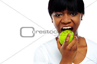 Close up shot pretty lady eating green apple