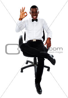 African corporate man showing okay gesture