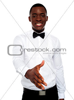 Attractive young man offering handshake