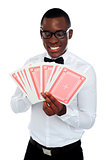 Young black man holding out deck of cards