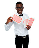 Young black boy ready to show his trump card