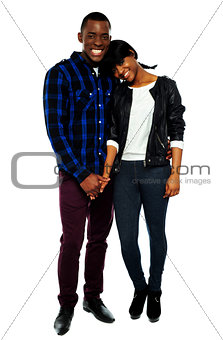 African young couple holding hands