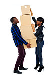 A young couple holds boxes in studio