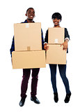 Attractive african couple holding cardboard boxes