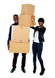 Love couple holding empty cartons