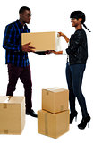 Couple moving empty cartons