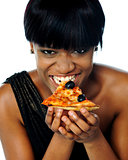 Woman enjoying pie of a pizza