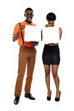 Attractive african couple with pizza boxes