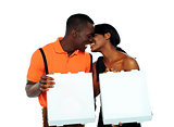 Black couple kissing and holding pizza boxes