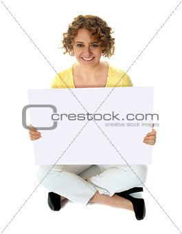 Isolated woman holding blank banner ad