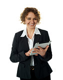 Aged businesswoman using touch screen device