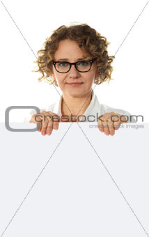 Aged woman behind big blank white banner ad