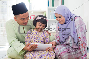 Asian family using tablet pc computer