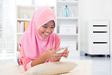Asian teen texting a message