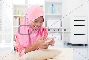 Asian teen texting a message