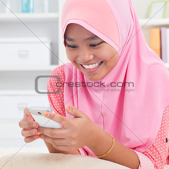 Asian teen texting on the phone
