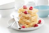 waffle with raspberry and icing sugar